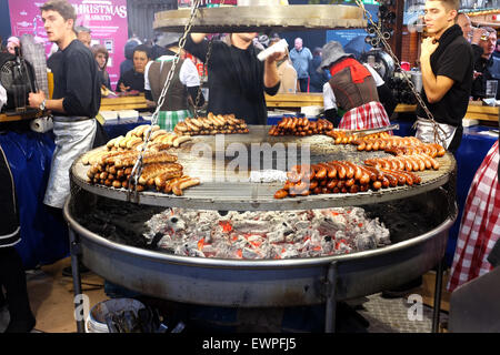 German Barbecue sausage stall at the Christmas Market in Albert Square, Manchester, England UK - Stock Photo