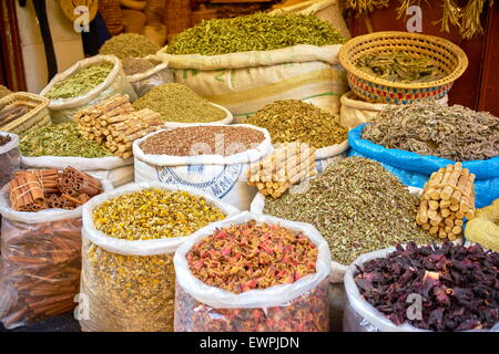 Sacks of dried flowers, rose petals, buds and herbs in the souk. Morocco - Stock Photo