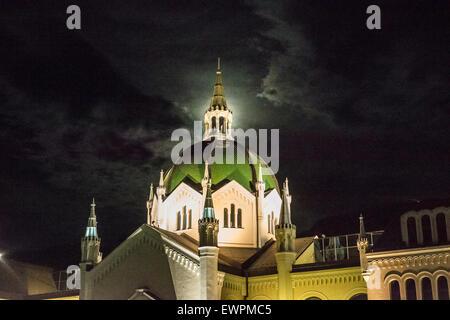 The Art Academy building  with 'Festina Lente' bridge in Sarajevo by night - Stock Photo
