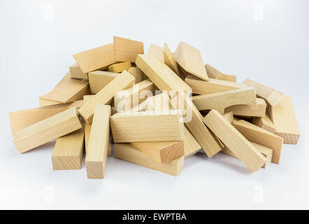 Stack or pile of wooden building blocks to build construction, isolated on white background - Stock Photo