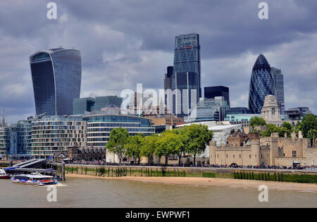 Skyline of the financial district, City of London, Tower of London on the right, The Gherkin behind, London, England - Stock Photo