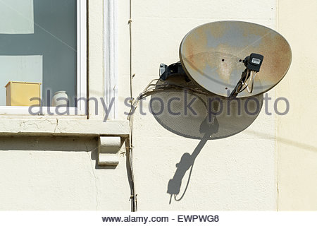 Satellite dish on terraced house, Blandford Forum, Dorset England UK - Stock Photo