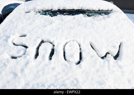 Word snow on windshield of car in winter season - Stock Photo
