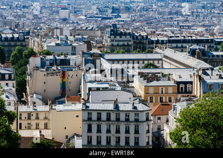View from the Butte of Montmartre across rooftops of Paris. France - Stock Photo