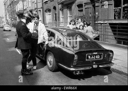 Rolling Stones: 28th August 1966 Mick Jagger's midnight blue Aston Martin DB6 was involved in collision with a Kraft - Stock Photo