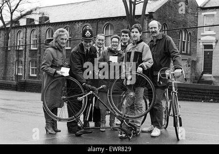 Paddock community policeman Pc Howard Fanning marks bicycles with the owner's postcode in a session held at Paddock - Stock Photo