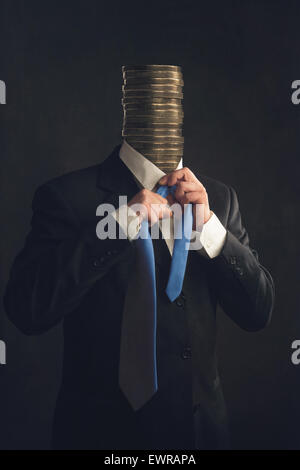Symbol Businessman in Suit with stack of coins instead a head - Stock Photo