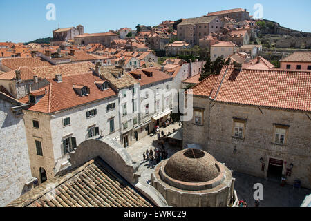 view of rooftops from wall of old city of dubrovnik, large onofrio fountain in foreground, croatia - Stock Photo