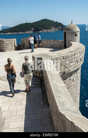 guard post on wall of old city of dubrovnik, lokum island in background, croatia - Stock Photo