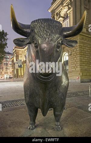 Germany, Frankfurt, bull in front of stock exchange, twilight - Stock Photo