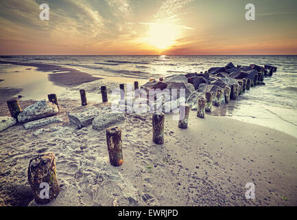 Retro vintage style beautiful sunset over Baltic Sea coast, Miedzyzdroje in Poland. - Stock Photo