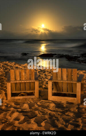 Chairs and moonset. Hawaii, The Big Isalnd. - Stock Photo