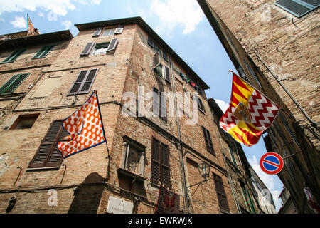 Siena is divided into 17 contrade neighbourhood districts and the neighbourhoods are clearly defined as seen here by the flags f