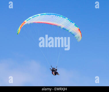 Tandem Paraglider against blue sky - Stock Photo