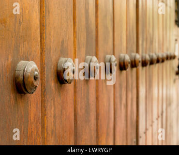 Wooden big door ancient style closeup from side angle - Stock Photo