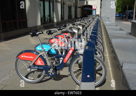 LONDON - MAY 13 2015:Santander Cycles Hire Station.London's public bike sharing scheme is available 24/7, 365 days - Stock Photo