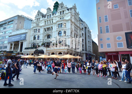 LONDON - MAY 13 2015:Street dancing show in Leicester Square London UK.The square is the prime location in London - Stock Photo
