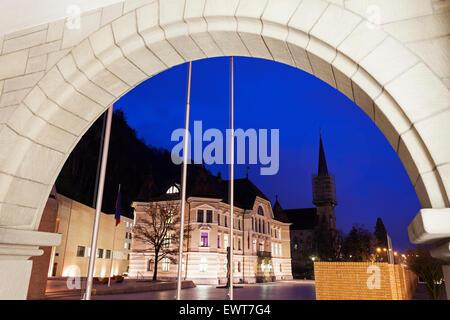Parliament building and Vaduz Cathedral - Vaduz, Liechtenstein - Stock Photo