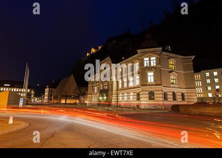 Parliament building in Vaduz during the evening traffic. Vaduz, Liechtenstein. - Stock Photo