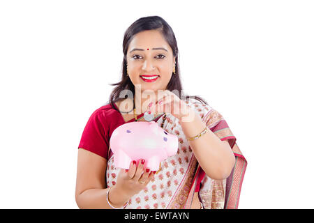 1 indian Woman Saving Money Piggy Bank - Stock Photo