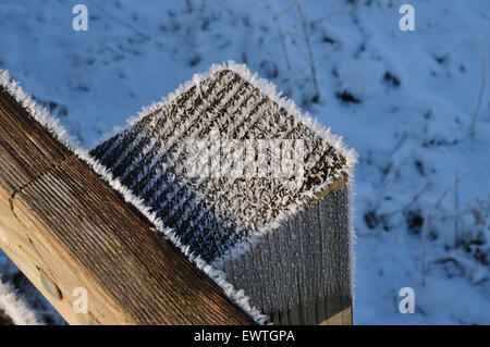 White frost on the top of a fence post. - Stock Photo