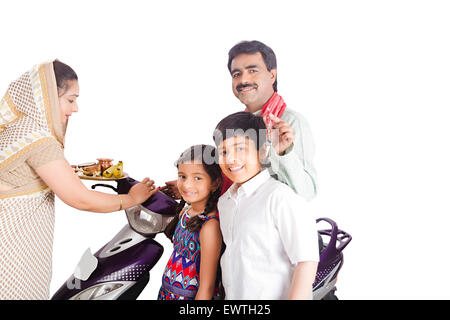 indian Rural Parents and kids new Scooty Worship - Stock Photo