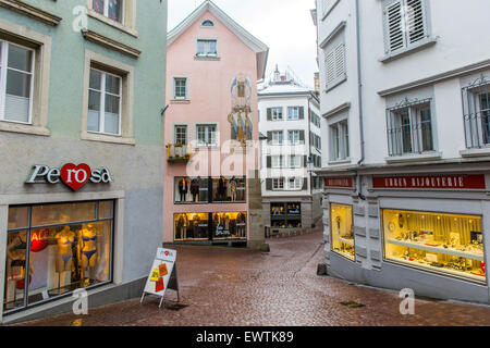 Narrow cobblestone lane with shops in Zurich Switzerland, Europe - Stock Photo