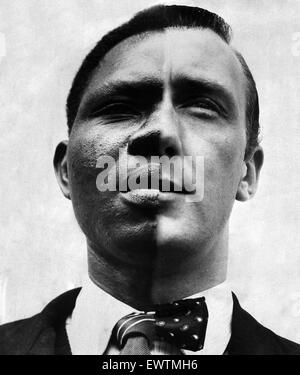 A split headshot portrait of a black man and a white man. Used in the Daily Mirror on the 6th September 1958 to - Stock Photo