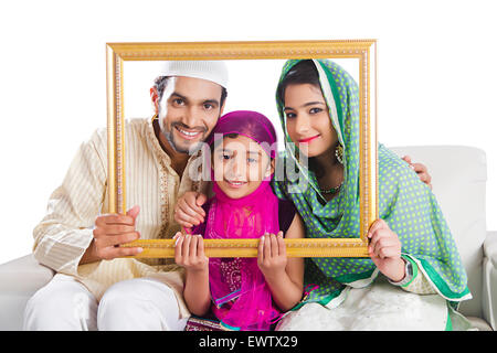 indian Muslim Parents and daughter Frame Photography - Stock Photo