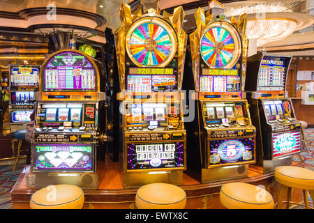 Slot machines in casino on board Royal Caribbean 'Brilliance of the Seas' cruise ship, North Sea, Europe - Stock Photo