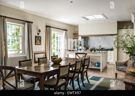 Antique Dining Table With Chairs In Open Plan Kitchen Room Limestone Flooring