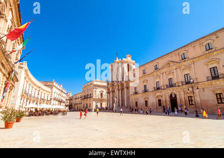 SYRACUSE, ITALY - AUGUST 16, 2014: tourists and locals visit main square Piazza del Duomo in Ortigia, Syracuse, - Stock Photo