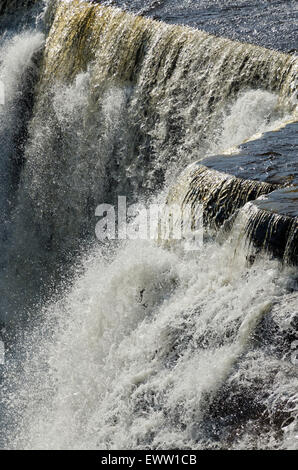 Cascading water over rocks in Kakabeka Falls - Stock Photo