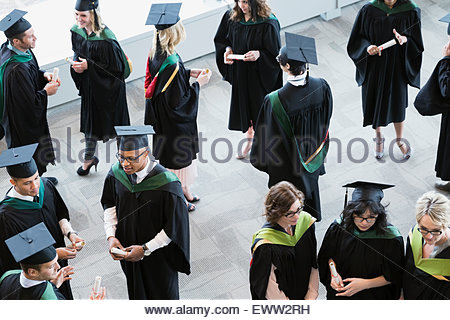 College graduates and professors socializing - Stock Photo