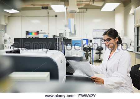 Scientist working at computer in laboratory - Stock Photo