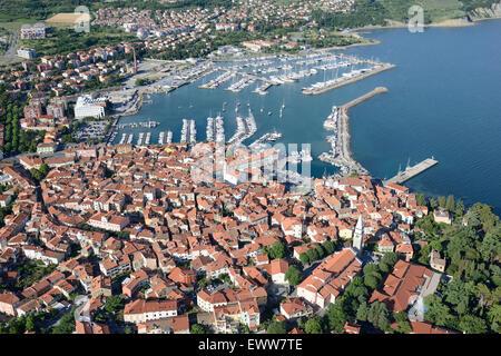 CITY OF IZOLA AND ITS MARINA (aerial view). city of Izola (also Isola, its Italian name), Slovenia. - Stock Photo