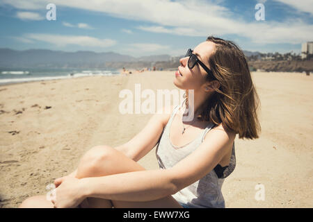 Beautiful young teen girl relaxing on Santa Monica beach in Los Angeles, California - Stock Photo