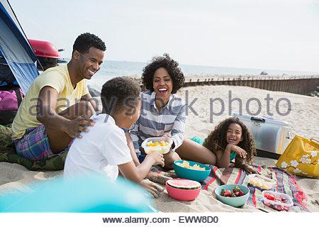 Family picnicking on beach - Stock Photo