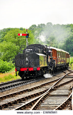 A steam train pulling into Highley Railway station on the Severn Valley Railway in Shropshire, UK. - Stock Photo