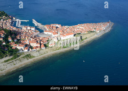 MEDIEVAL CITY JUTTING OUT INTO THE ADRIATIC SEA (aerial view). City of Piran (or Pirano, its Italian name). Slovenia. - Stock Photo