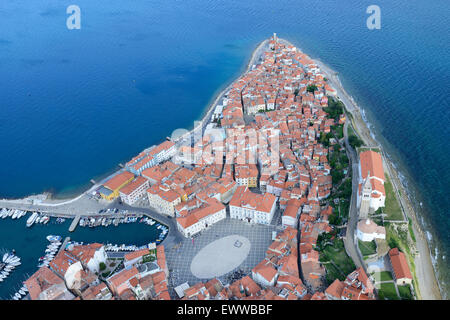 MEDIEVAL CITY JUTTING OUT INTO THE ADRIATIC SEA (aerial view). City of Piran (or Pirano, its Italian name), Slovenia. - Stock Photo