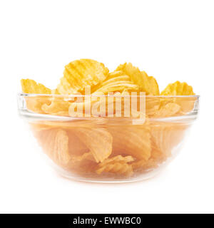 Multiple potato chips in a glass bowl - Stock Photo