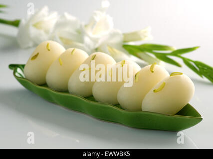Delicious Chum Chums in beautiful Dish - Stock Photo
