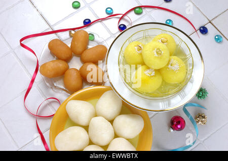 Chum Chum's Variety (Sweet Dumplings in Sugar Syrup) - Stock Photo