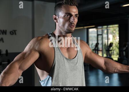 Bodybuilder Doing Exercise For Shoulder - Stock Photo