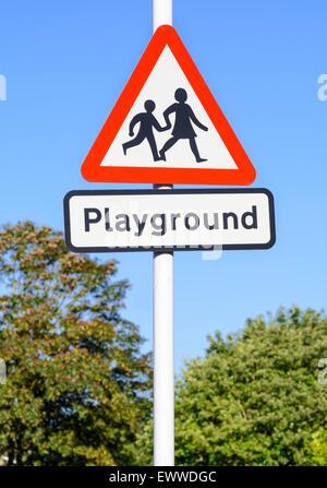 Triangular playground warning sign near a school in the UK. - Stock Photo