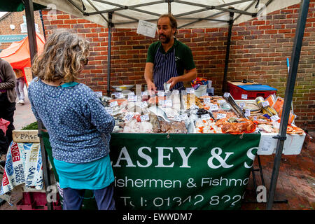 A Woman Buying Fresh Fish At The Lewes Food Market Held Every Friday In The County Town Of Lewes, Sussex, UK - Stock Photo