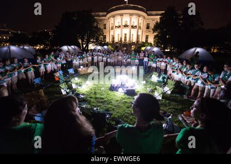 Washington DC, USA. 30th June, 2015. Girl Scouts participate in a Friendship Circle around a campfire during the - Stock Photo