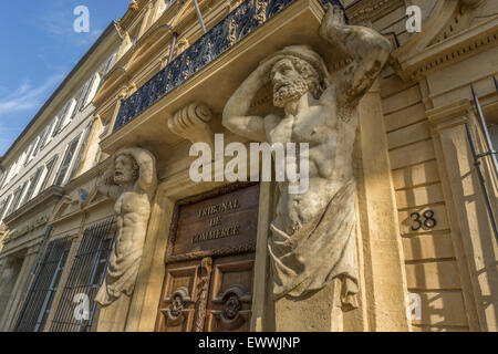 Dorway with caryatids, Tribunal de Commerce, Atlas Figures,   Cours Mirabeau, Aix-en-Provence, Bouches-du-Rhone - Stock Photo