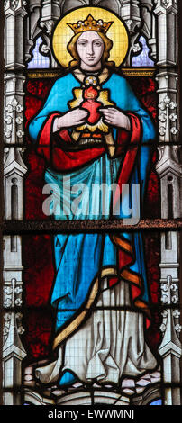Stained glass window depicting Mother Mary in the Church of Stabroek, Belgium. - Stock Photo